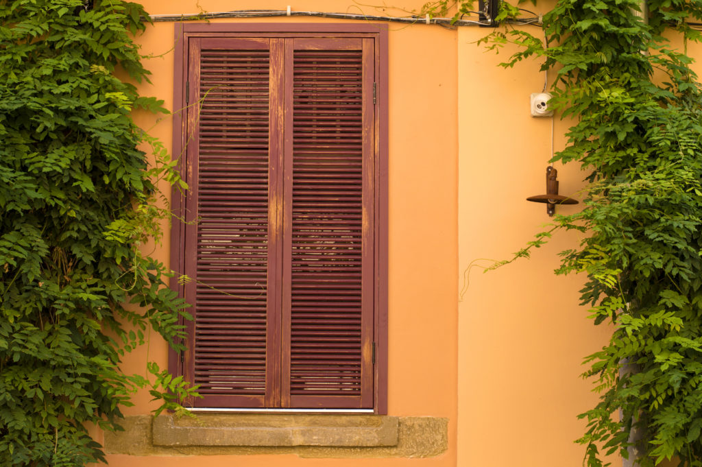 You can repurpose old shutters by creating a shutter fence.