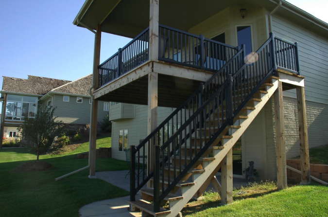 A set of apartment stairs with vinyl fencing, reflecting the benefits of installing vinyl fencing in an apartment or home.