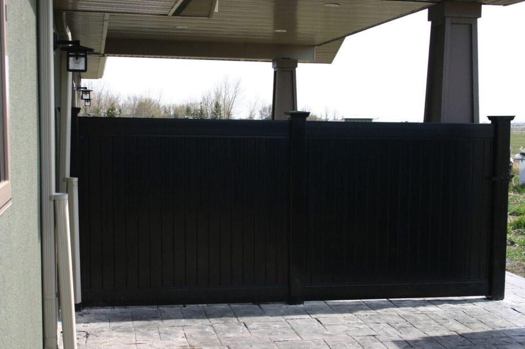 Solid Black Vinyl Privacy Fence in Backyard