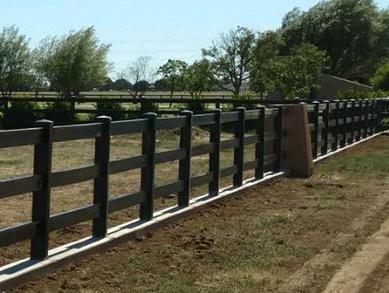 A black vinyl ranch rail fence made by Blackline HHP