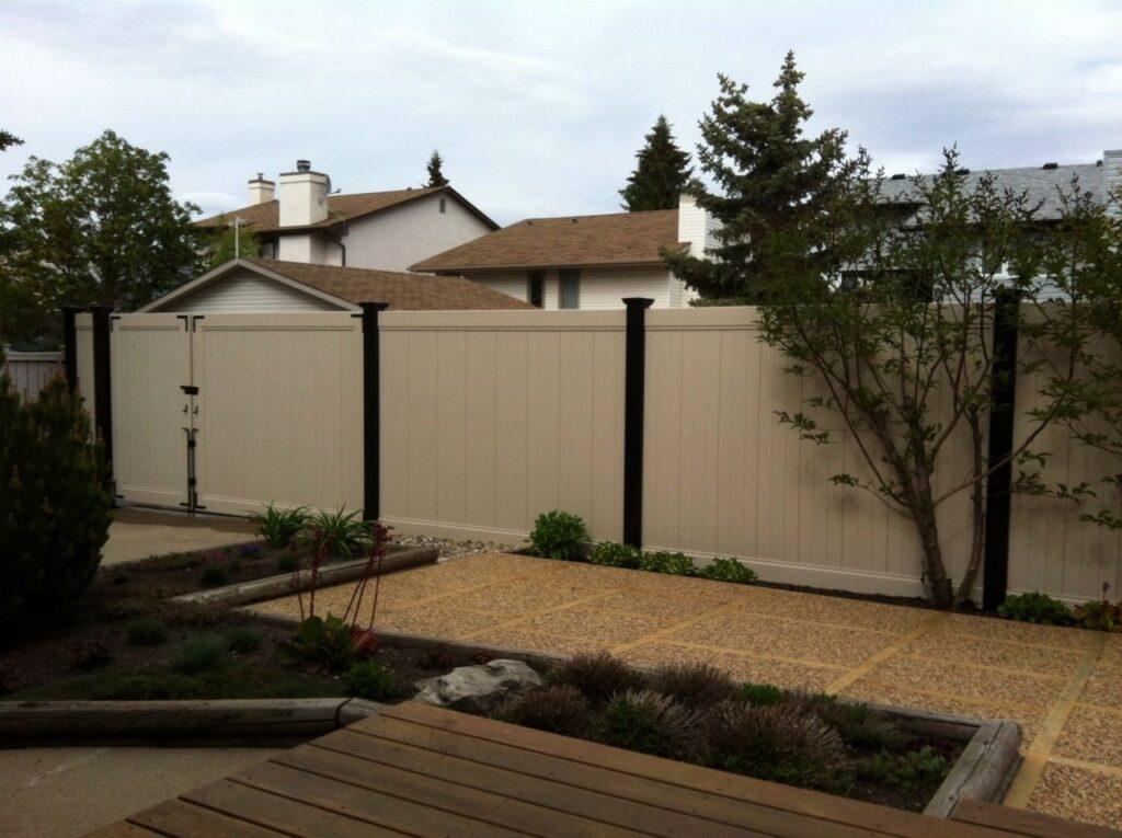 A white vinyl fence on property line made by Blackline HHP.